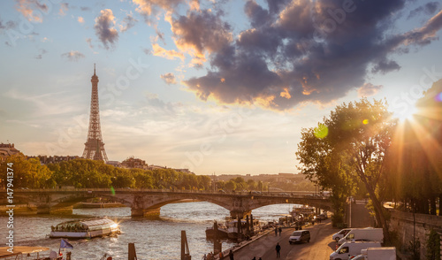 Paris with Eiffel Tower against colorful sunset in France