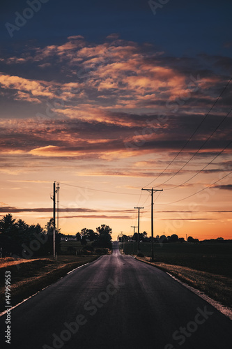 Plexiglas Brug sunset above a rural road