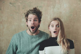 Wow! Surprised man and woman with open mouth, young couple - 147968317