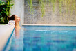 Leinwanddruck Bild - Beauty and body care. Sensual young woman relaxing in outdoor spa swimming pool.