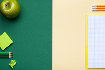 School Accessories on Green and Yellow Background