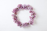 Lilac Flowers Wreath  on Wooden Background - 148012564