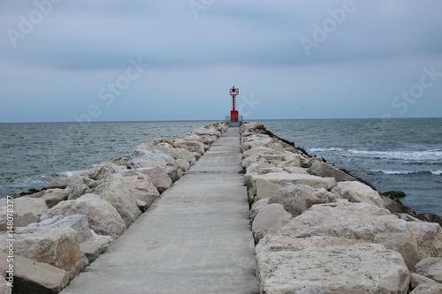 Lighthouse and mole in Porto Garibaldi, on the Adriatic coast