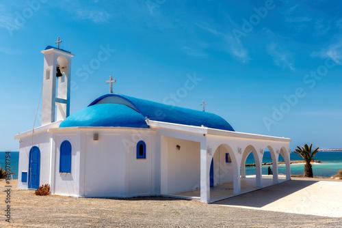 In de dag Cyprus White chapel on a shore near Aiya Napa, Cyprus.