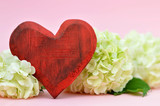 Heart and flowers on pink background