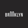Logo of the Brooklyn bridge. Silhouette of the bridge in the font.