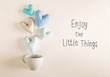 Enjoy The Little Things message with blue heart cushions