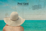 Vintage summer postcard. Girl with hat on the beach