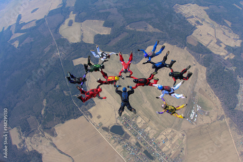 Skydivers in the sky Poster