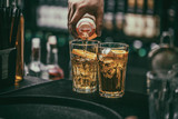 Fototapeta Bartender pours alcoholic drink