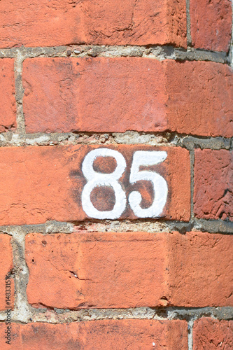 Poster House number 85 painted sign