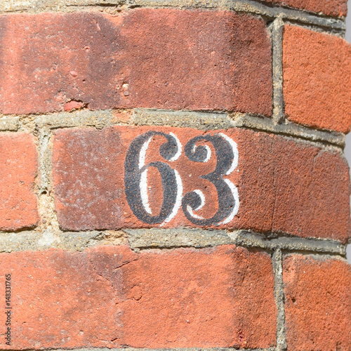Poster House number 63 painted sign