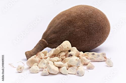 Baobab fruit (Adansonia digitata) on white background, pulp and powder, superfood