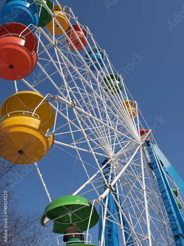 Poster Big ferris wheel against the blue sky
