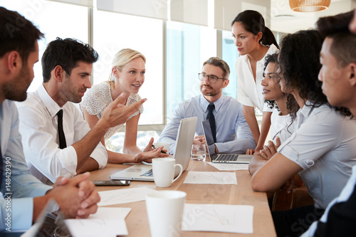 Group Of Businesspeople Meeting Around Table In Office