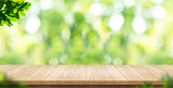 Empty wood plank table top with blur park green nature background bokeh light,Mock up for display or montage of product,Banner or header for advertise on social media,Spring and Summer concept - 148460976