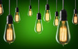 Vintage light bulbs on green background