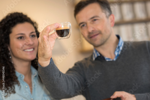Man and woman examining coffee