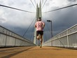 Man running over foot bridge