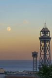Barcelona lighthouse next to the moon