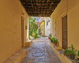 Greek island, scenic view of alley to a secret yard - 148725319