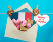 Happy Mother's Day Card in French. Envelope with paper hearts and a bouquet of flowers