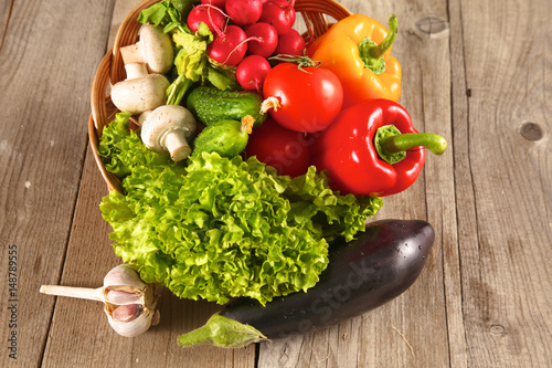 Composition with assorted raw organic vegetables wooden table