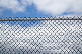 iron chain link fence against sky - 148859546