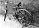Black and white image of an old vintage bicycle