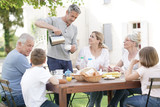 Fototapeta Family having breakfast together in holiday home