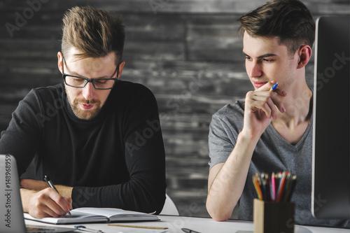 Young guys doing paperwork