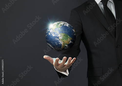 Businessman magical touch concept -  world Poster