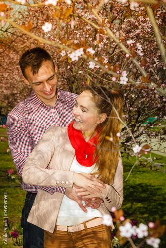 Happy couple having romantic date in park Poster