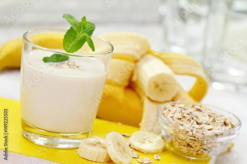 Foto op Canvas Milkshake Banana milk shake with oat
