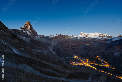 Aerial view of Breuil Cervinia village glowing in the night, famous ski resort in Aosta Valley, Italy Poster