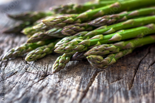 Fresh organic asparagus on rustic background