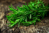 Fresh green aromatic rosemary on wooden table - 149267927