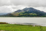 Panorama view on agricultural fields near Batur volcano, Kintamani. Winter rainy and cloudy season. Bali, Indonesia.
