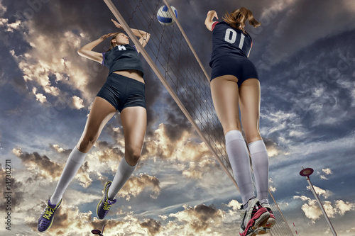 Fototapeta Female volleyball players jumping close-up