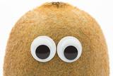 Fototapety kiwi face with googly eyes on white background