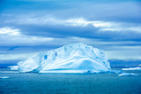 The shapes of icebergs drifting in Paradise Bay, Antarctica, are carved by the sea and winds. - 149424111