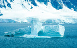 The shapes of icebergs drifting in Paradise Bay, Antarctica, are carved by the sea and winds.
