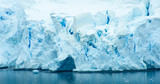 The blue and turquoise hues of the ice and snow along the shoreline of Antarctica are common sights with the coldest continent on Earth. - 149433757