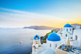 Classical view from sunset point at Oia village white and blue architecture, Santorini island, Greece. Incredible evening scenery. - 149446315