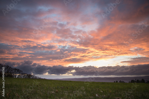 Beautiful Sunset over Meadow with Mountain View  - 149481165