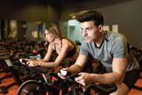 Couple in a spinning class wearing sportswear. - 149561526