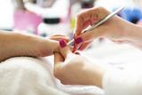 Enjoying Pedicure in Beauty Salon.