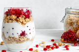 diet dessert with yogurt, granola and pomegranate fruit in a glass