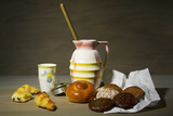 vintage style food still life with pastry and old dishes