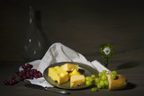 vintage style food still life with various cheese and grapes
